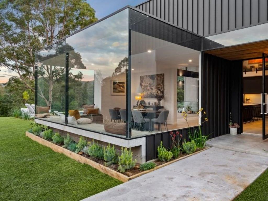 Floor-to-ceiling glass windows.