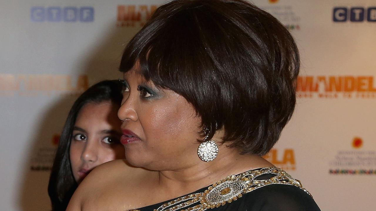 Kate, Duchess of Cambridge, left, meets Zindzi Mandela, right, the daughter of former South African President, Nelson Mandela, as they attend the Royal Film Performance of Mandela: Long Walk to Freedom, at the Odeon Leicester Square, London, Thursday, Dec. 5, 2013. South African President, Jacob Zuma, announced the death of former South African President Nelson Mandela, to the media Thursday evening Dec. 5, 2013, in South Africa. (AP Photo/Chris Jackson, Pool) Picture: Ap