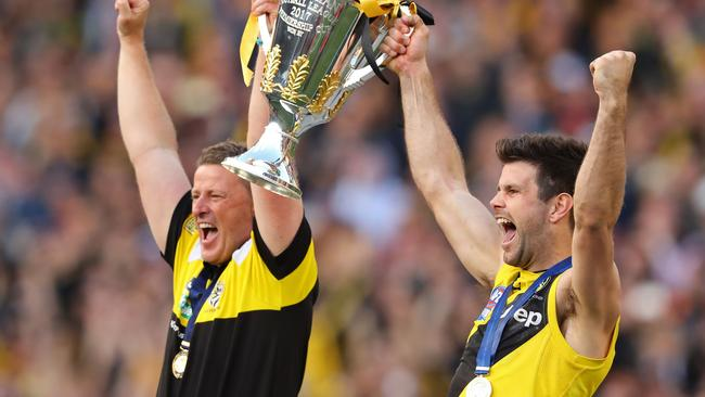 Damien Hardwick and Trent Cotchin hold up the 2017 premiership cup.