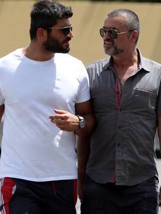 Musician George Michael (R) walks hand-in-hand with Fadi Fawaz in Woolloomooloo, Sydney, in 2012. Picture: Supplied