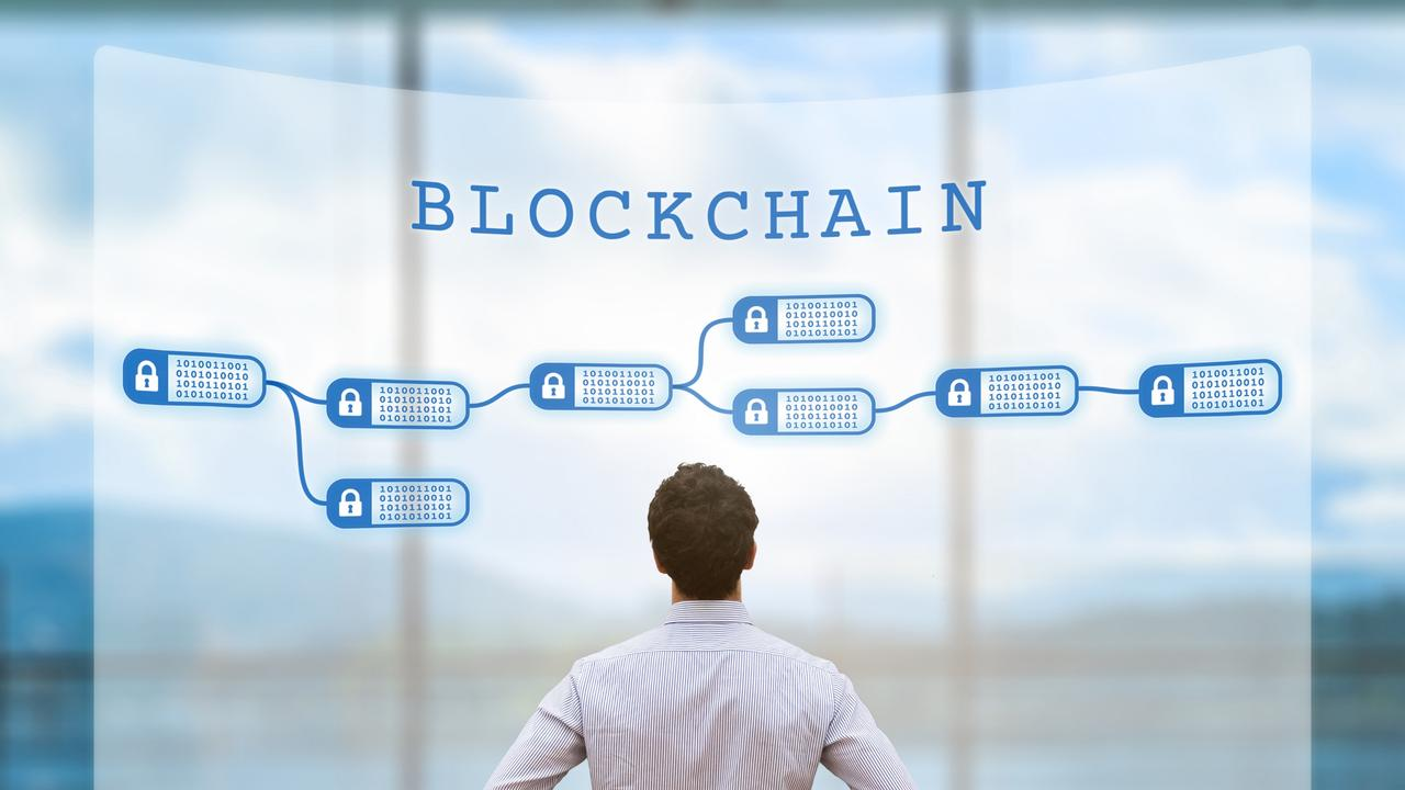 Person looking at blockchain concept on screen, cryptocurrency, business, fintech