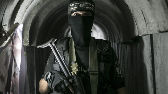 A Palestinian Hamas soldier poses in a newly reconstructed tunnel during a weapons exhibition held at an Hamas-run youth summer camp in Gaza City in July 2016. Picture: Ibrahim Khatib