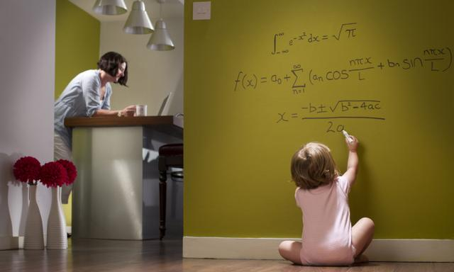 baby girl works out her equations whilst mum is oblivious