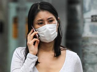 A young women in Sydney wears a face mask during the Coronavirus outbreak.