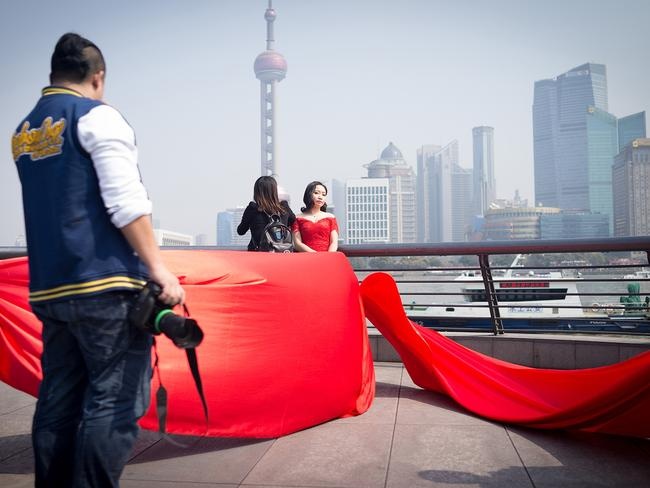 Couples spend thousands of dollars on all-day shoots.