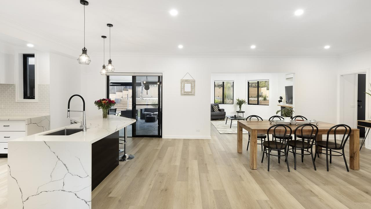 The stylish kitchen overlooks a spacious open plan meals and living zone.