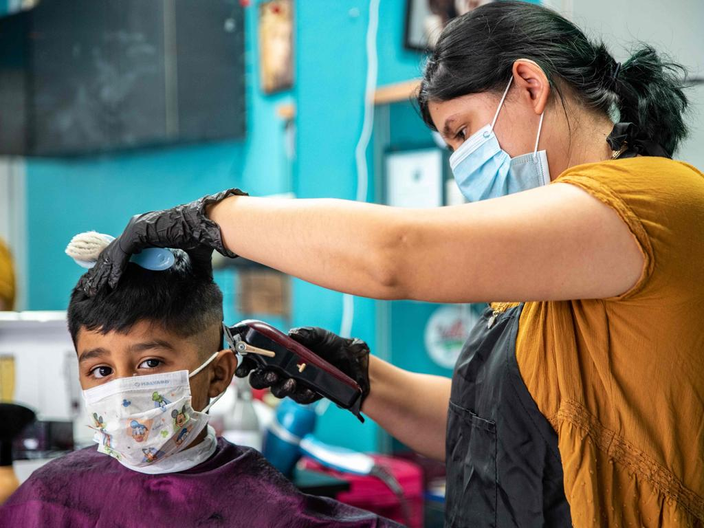 A young man gets his hair cut at a barber shop amid the coronavirus pandemic in Austin, Texas as the US looks to ease lockdowns. Picture: AFP