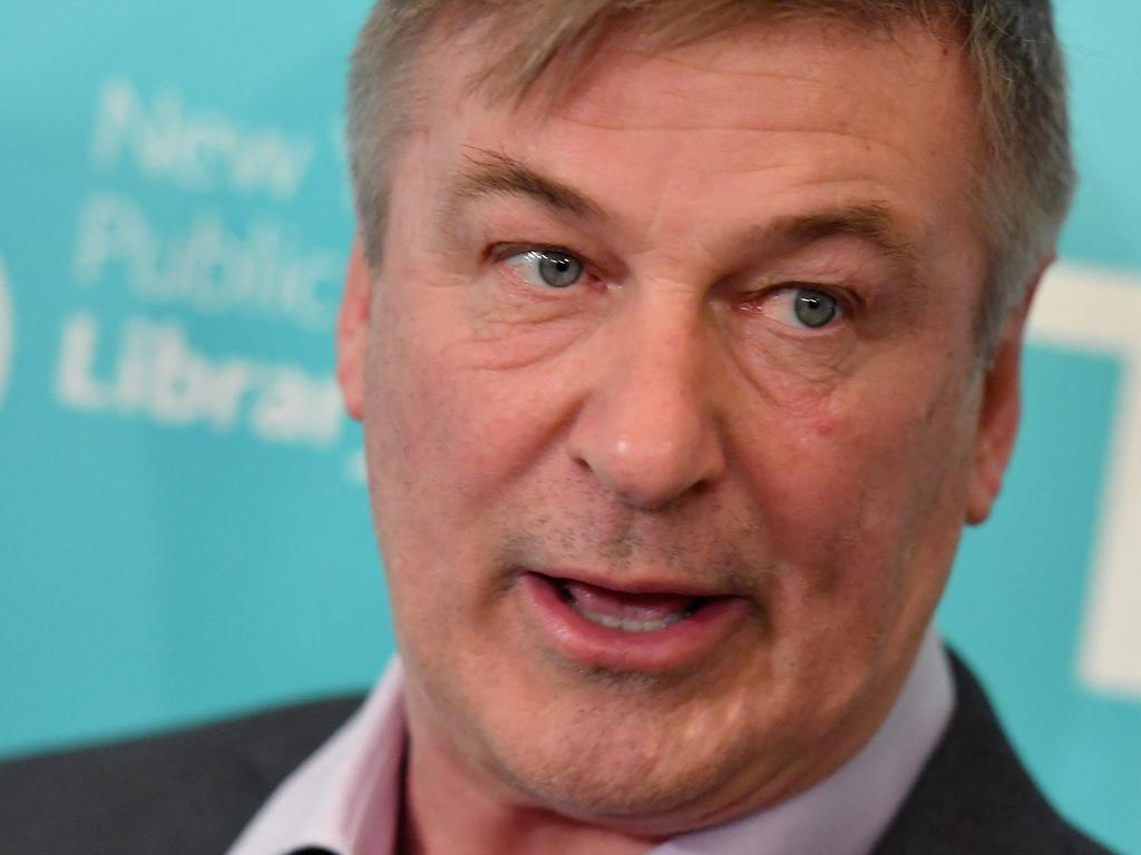 """(FILES) In this file photo taken on April 01, 2019, US actor Alec Baldwin attends the premiere of """"The Public"""" at New York Public Library in New York City. - Baldwin was the focus on October 22, 2021, of investigations into a shocking and deadly on-set tragedy, after the actor fired a prop gun that killed a cinematographer and wounded the director of a Western he was shooting in New Mexico. Halyna Hutchins and Joel Souza """"were shot when a prop firearm was discharged by Alec Baldwin,"""" the sheriff in Santa Fe said in a statement. Hutchins, 42, was transported to hospital by helicopter but died of her wounds, while Souza, 48, was taken by ambulance and was receiving treatment. (Photo by Angela Weiss / AFP)"""