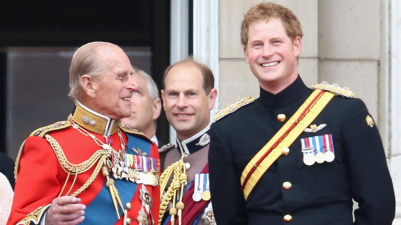 Prince Harry and Prince Philip sharing a joke on the balcony during the 2014 Trooping of the Colour. Picture: Chris Jackson/Getty Images