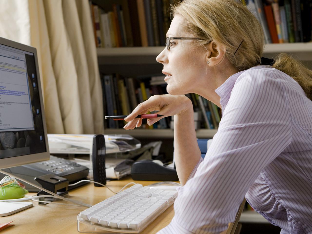 Woman studying computer screen. Generic image. Thinkstock.