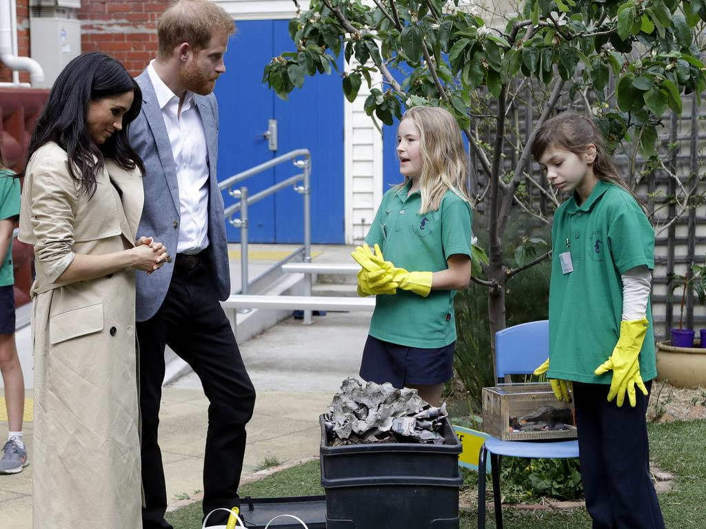 These girls showed off the school's compost and worm farm. Picture: Kirsty Wigglesworth
