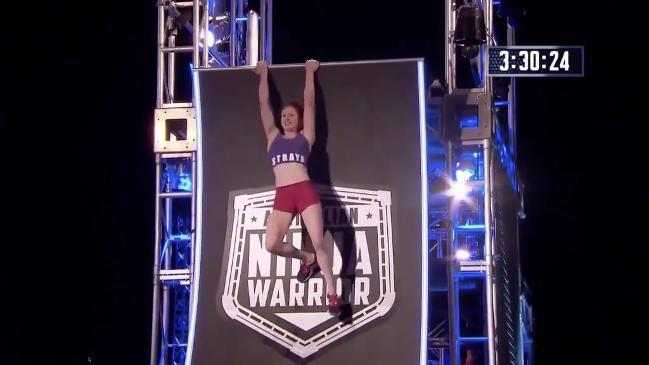 Female ninja pulls of crazy move to get up the warped wall