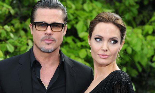 """LONDON, ENGLAND - MAY 08:  Brad Pitt and Angelina Jolie attend a private reception as costumes and props from Disney's """"Maleficent"""" are exhibited in support of Great Ormond Street Hospital at Kensington Palace on May 8, 2014 in London, England.  (Photo by Eamonn M. McCormack/Getty Images)"""