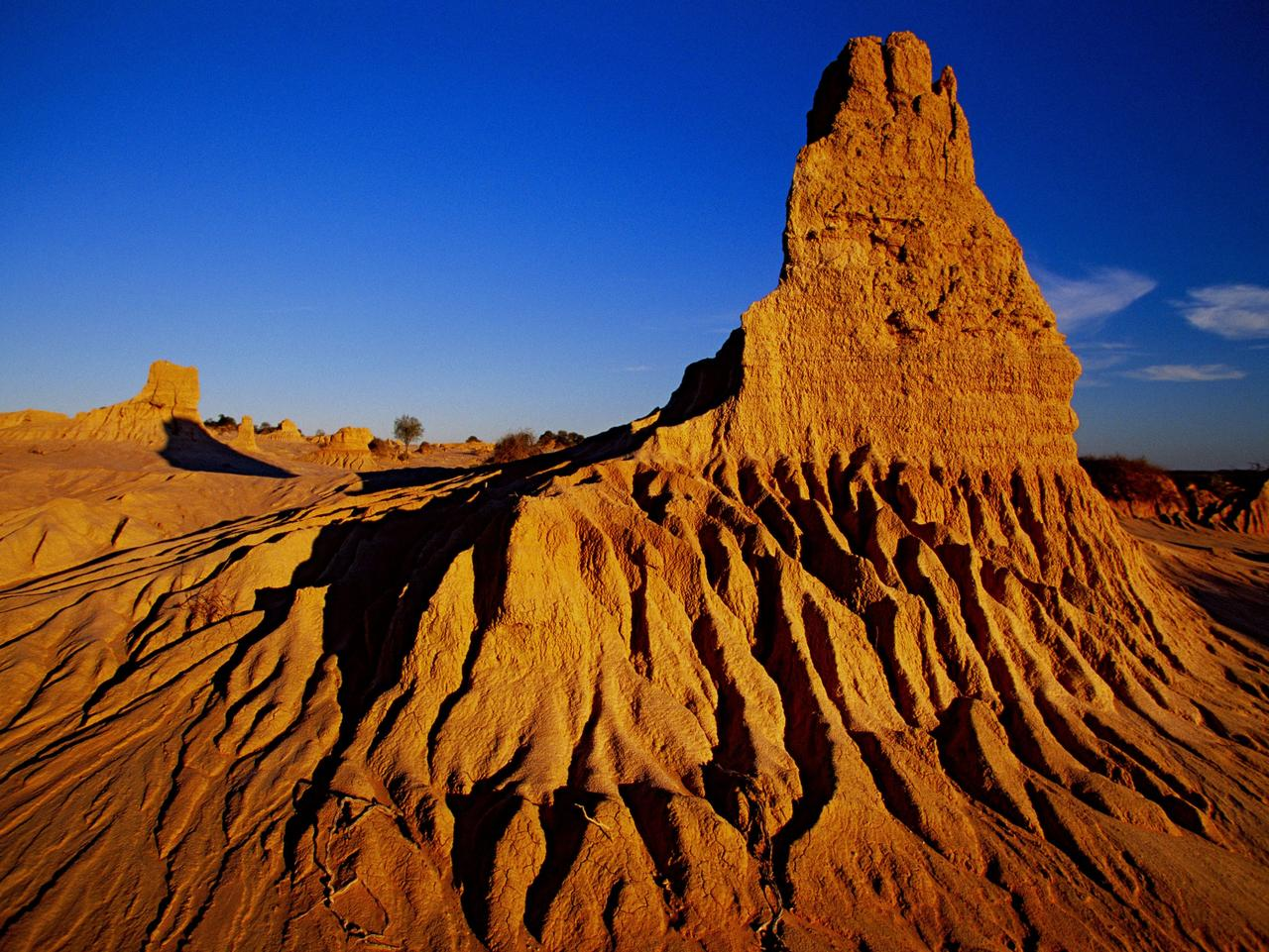 Walls of China in Mungo National Park at Willandra Lakes, NSW, one of the Top 10 Best-kept Secret Holiday Destinations/Attractions in NSW. Pic credit NSW Tourism/Don Fuchs.