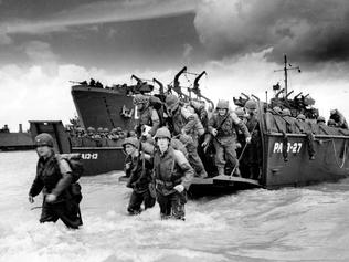 Normandy, France, June 6, 1944. D-Day, the Allied soldiers disembark from transport ships, World War II