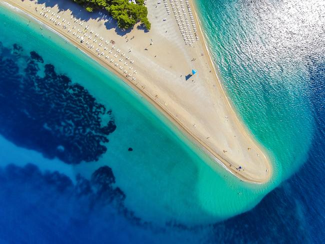 BRAC: Most of us are here at Bol for Zlatni Rat, the tongue-shaped beach jutting more than 500m into the Dalmatian sea and admired from a bird's eye view. Named the Golden Horn, it got its shape from pebbles and sediment near the underwater reef that spread to form its tongue-like formation.