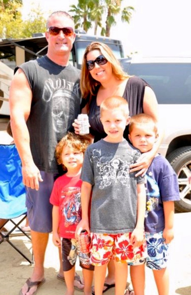 John and Cassondra, with their three boys, were married for 10 years. Picture: Caters News Agency