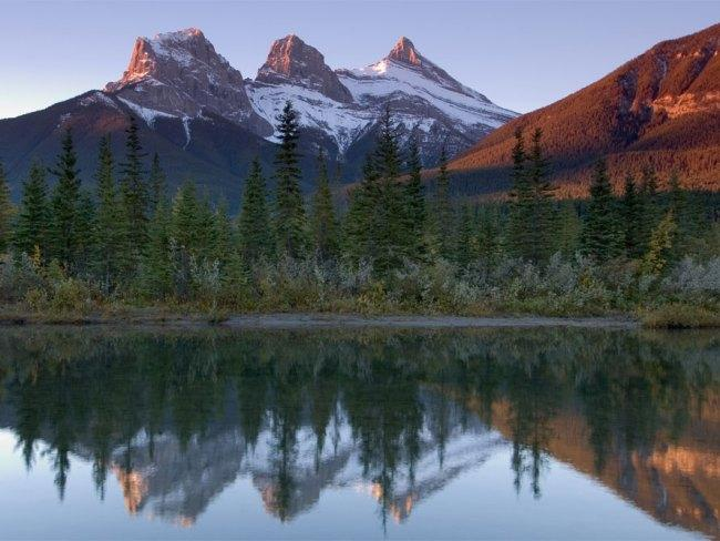 Brokeback Mountain: Alberta, Canadian Rockies, CanadaSet in Wyoming, USA, but filmed in  Canada, Ang Lee's story of romance, sadness and family between two cowboys was filmed in the Canadian Rockies, close to Banff. Mountains such as the Three Sisters (pictured) made up the peaks of 'Brokeback Mountain'.