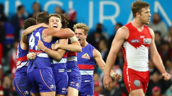 Western Bulldogs players celebrate the win over Sydney.
