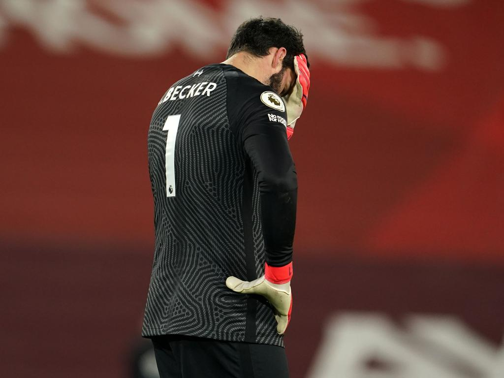 Liverpool's Brazilian goalkeeper Alisson Becker reacts after conceding their third goal. (Photo by Jon Super / POOL / AFP)