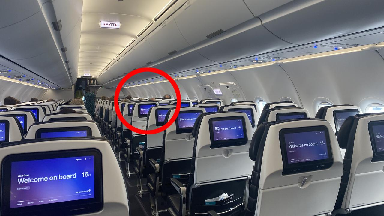 Despite heading into the weekend, the flight from New Zealand to Australia had very few passengers. The upside is that everyone had a row to themselves. Picture: Vanessa Brown/news.com.au