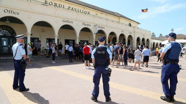 Police in attendance at Bondi Beach Pavilion on Saturday as Police Minister David Elliott announced the beach would be closed. Picture: Matrix