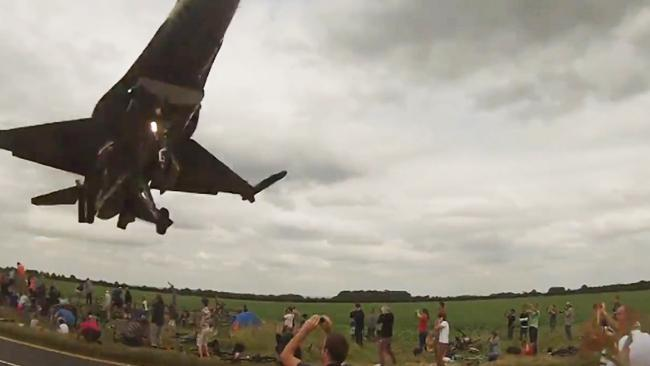 Low flying jet nearly cleans up spectators