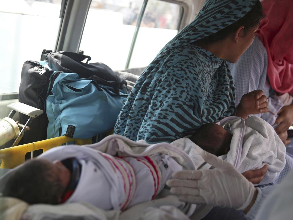 Babies are taken away by ambulance after gunmen attacked a maternity hospital, in Kabul, Afghanistan. Picture: AP