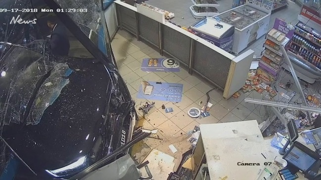 Man bashes and drags pregnant woman, drives his car through service station window as she cowers inside