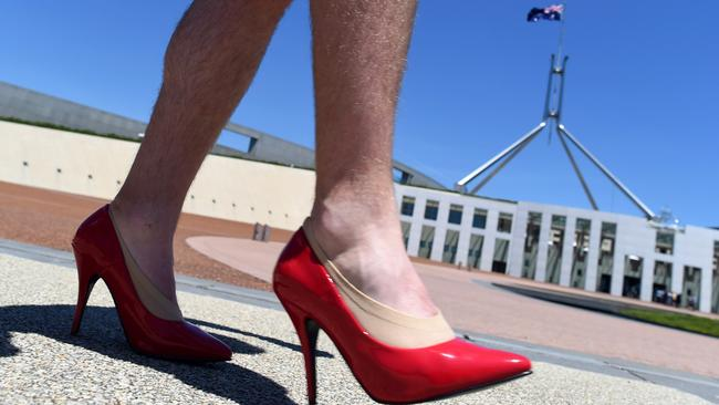 """Does this say """"let's do something serious about domestic violence"""" to you? Picture: AAP Image/Lukas Coch"""