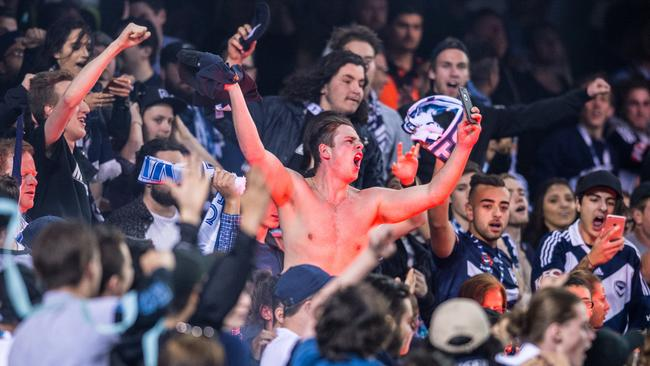 A flare is let off during the Melbourne Derby.