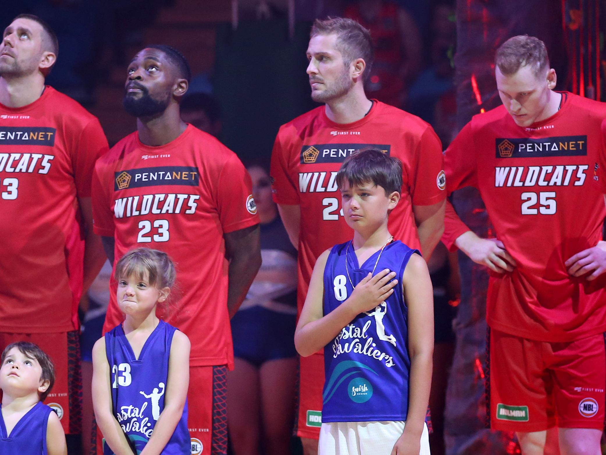 Exeter's children stand alongside the Wildcats during one minute's silence.