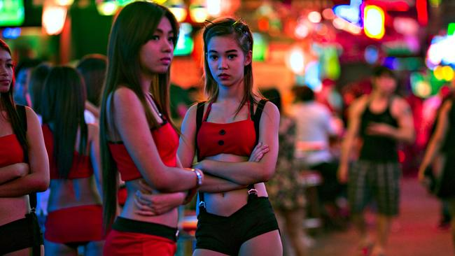 Two Thai women working at a bar in the red light district in Bangkok, a popular destination for Australia sex tourists. Picture: Paula Bronstein/Getty Images