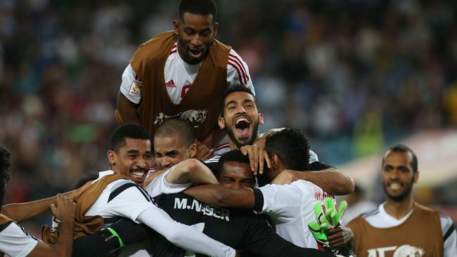 United Arab Emirates players celebrate a famous victory over Japan.