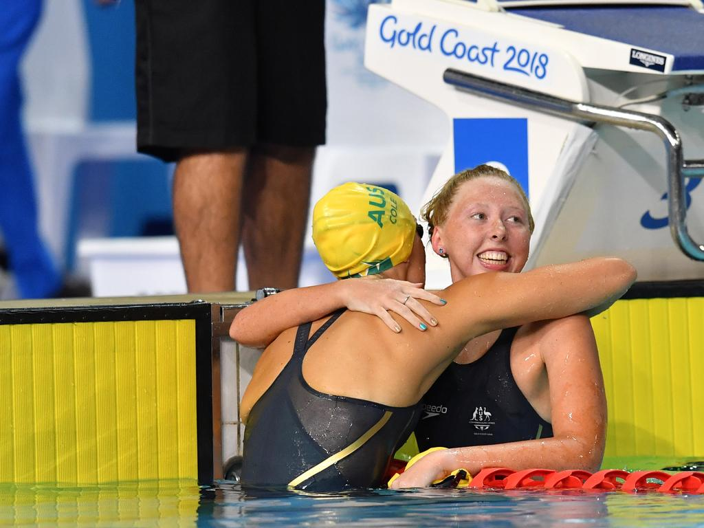 Lakeisha Patterson  hugs Ellie Cole after winning the Women's S9 100m Freestyle Final. Picture: AAP Image/Darren England