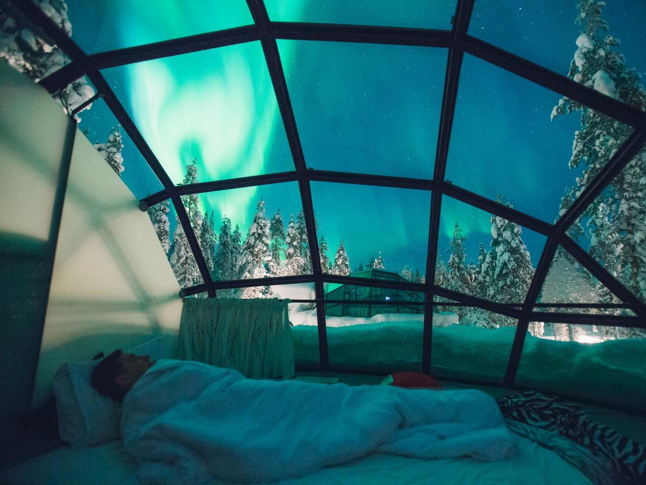 SUNDAY ESCAPE. NORTHERN LIGHTS. Kakslauttanen Arctic Resort, Finland. Picture: Kakslauttanen Arctic Resort
