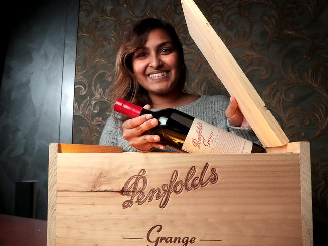 Daphne Reddy with one of the bottles of Penfolds Grange, which will auctioned this Sunday as a full set by du Plessis auction house. Picture: Dylan Coker