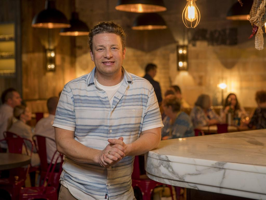 Jamie Oliver in his Brisbane restaurant. The celebrity chef says he's saddened by the collapse of his Jamie's Italian empire. Picture: Peter Wallis