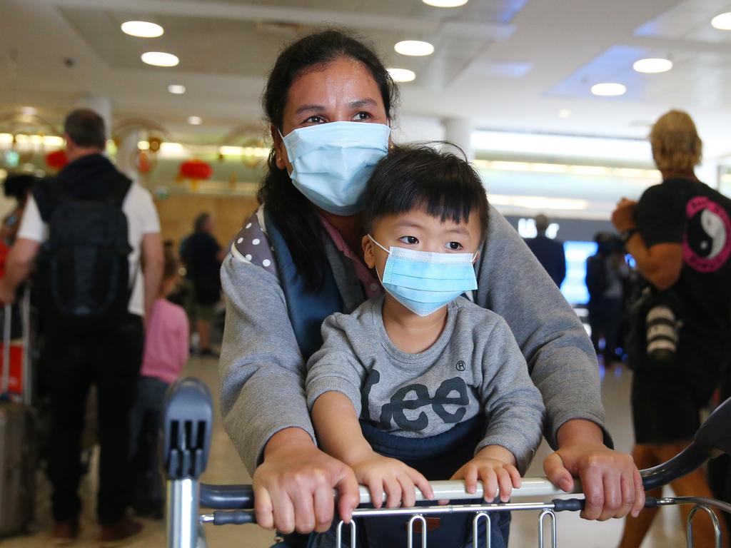 Passengers arrive in Sydney after a flight from Wuhan. Picture: Don Arnold/Getty Images)