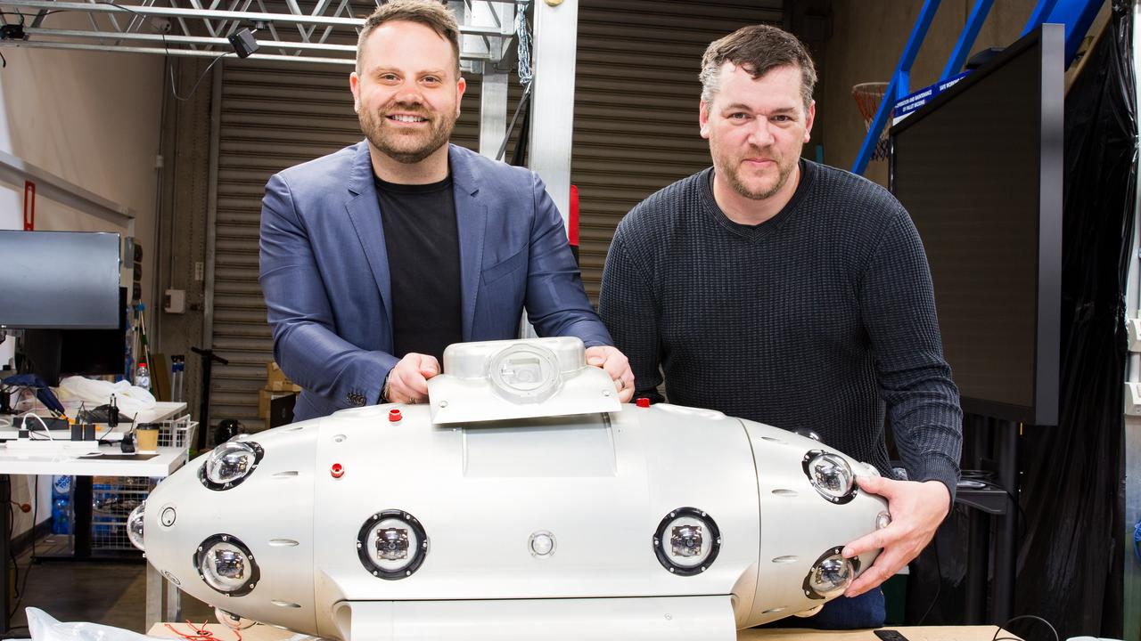 Ben Fleming and Shawn Taylor with their submarine. Picture: AAP/UAM Tec