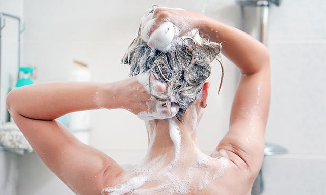 woman shampooing hair