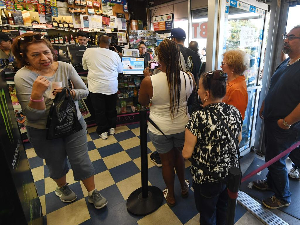 Customers line up, back in October, for a chance at winning over a billion dollars. Picture: AFP