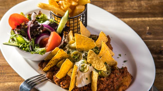 ... the Dirty Gringo is a schnitzel topped with mexican spiced ground beef, mild salsa, corn chips, avocado, Jalapenos and sour cream ...