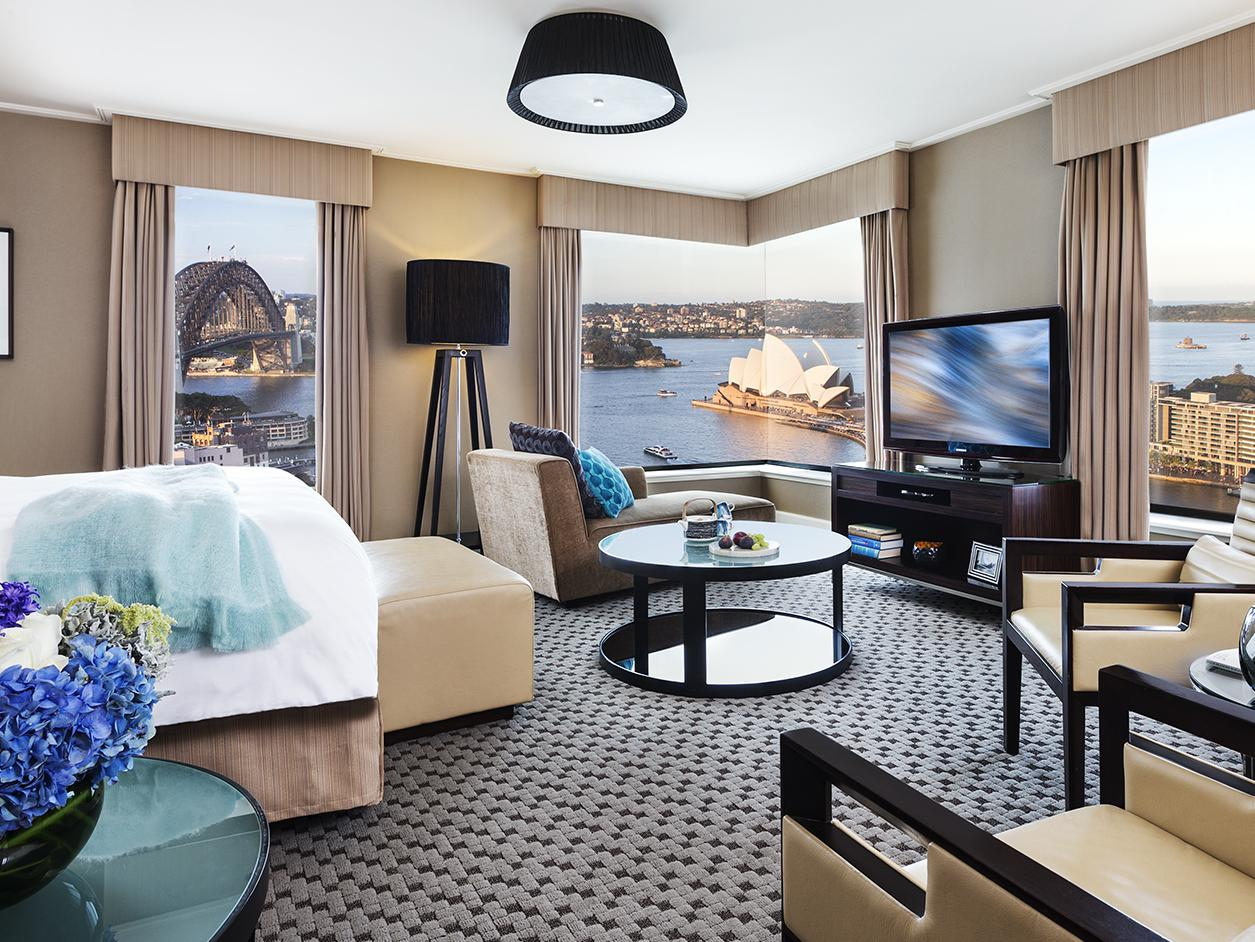 Watch the view or something on the box while you munch on the Four Seasons Sydney room service.