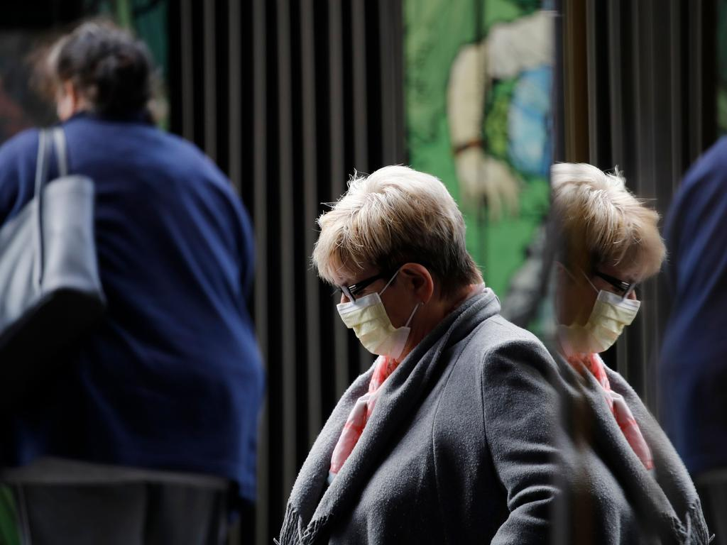 A woman wears a protective face masks in the street ahead of the announcement by Swiss government of new restrictions. Picture: Stefan Wermuth/AFP