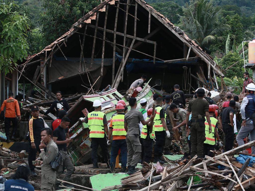 Rescuers look for survivors along the coast in South Lampung on South Sumatra. Picture: AFP