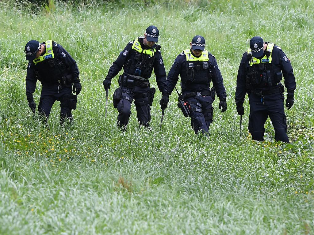 Police conduct a line search at Dandenong Creek in Bayswater after Mr Virgona was shot and killed on the EastLink Freeway. Picture: Julian Smith/AAP