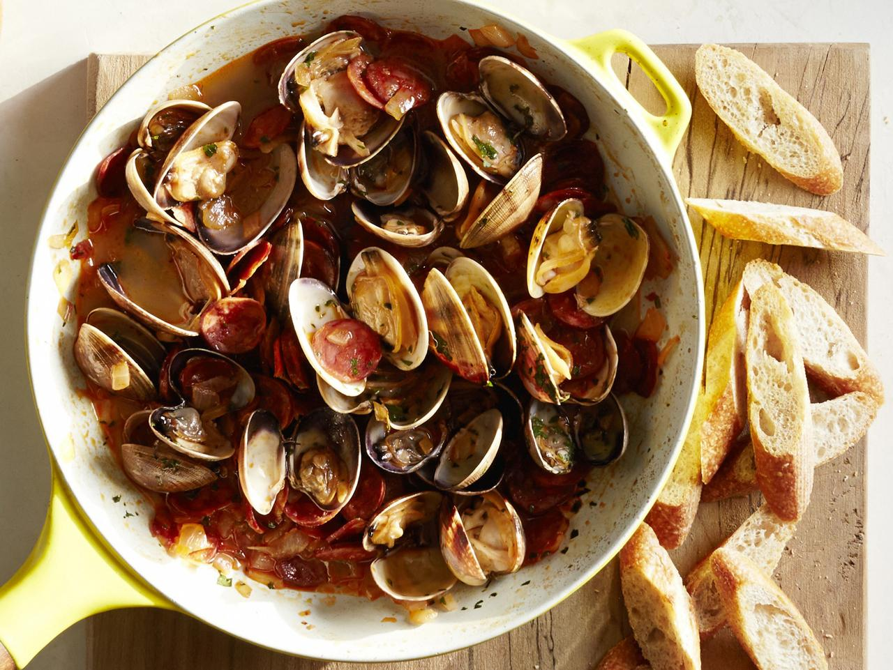 ESCAPE: Celebrity chefs on cruises. Jose Garces cuisine, clams with Chorizo on the Norwegian Cruise Line. Picture: Supplied