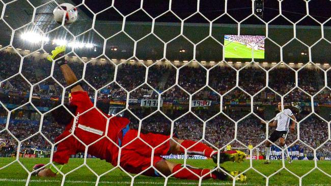 Gianluigi Buffon tries to get a hand to Mats Hummels penalty.