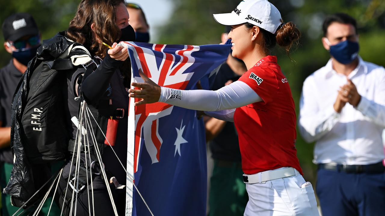 Minjee Lee of Australia is presented with an Australia flag in France. Picture: Stuart Franklin/Getty Images